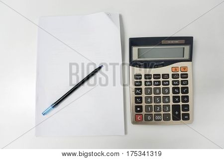 Calculator for tax and salary calculation with blank white paper sheet