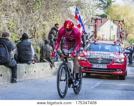 Conflans-Sainte-HonorineFrance-March 62016: The Russian cyclist Pavel Kochetkov of Katusha Team riding during the prologue stage of Paris-Nice 2016.