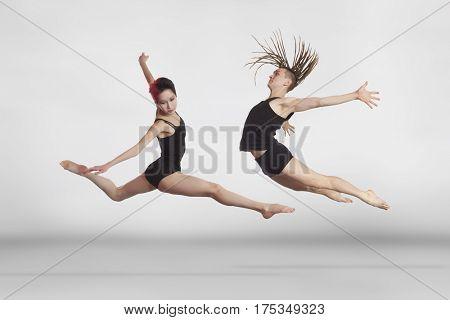 Ballet dancer in black body series on gray background