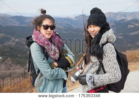 Portraint two Females on peak of Omuro volcano mount on Ito city ShizuokaJapan.