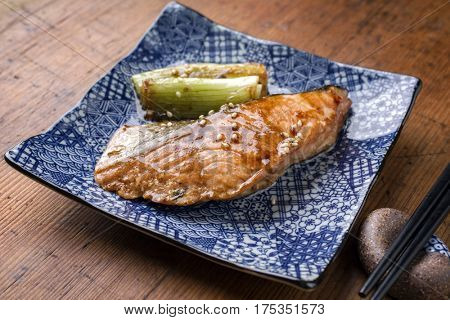 Japanese fish Teriyaki with Tsukemono Vegetable as close-up on a bowl