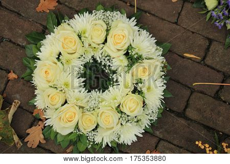 Sympathy wreath made of various white flowers