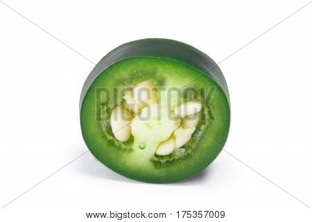 Slice of green Serrano pepper (Capsicum annuum). Clipping path shadow separated