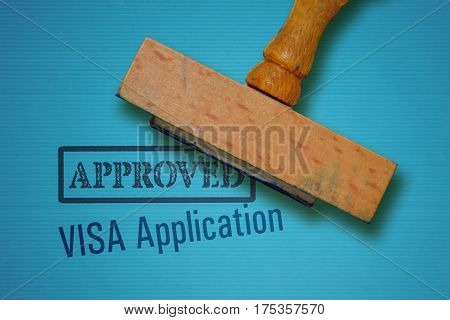 Text Visa Application and rubber stamp on blue background