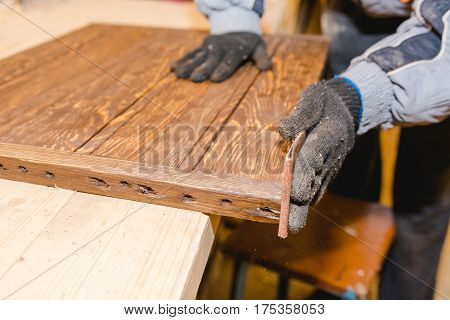 The Man Grinds Wood. The Joiner Processes Wooden Boards. Joiner's Works Of The House.