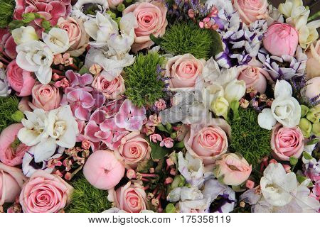 Wedding arrangement in various shades of pink and different sorts of flowers