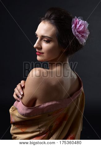 young beautiful woman in traditional japanese kimono