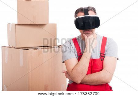 Mover Guy Wearing Virtual Reality Glasses Making Thinking Gesture