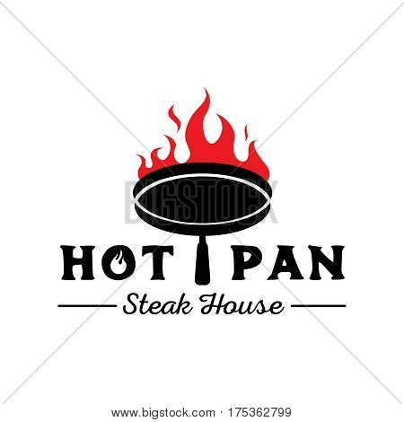 hot pan steak house logo design with pan on fire