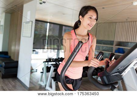 Sport Woman running with Elliptical machine