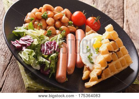 Savory Breakfast: Waffles With Egg, Sausages, Beans And Fresh Salad Close-up. Horizontal