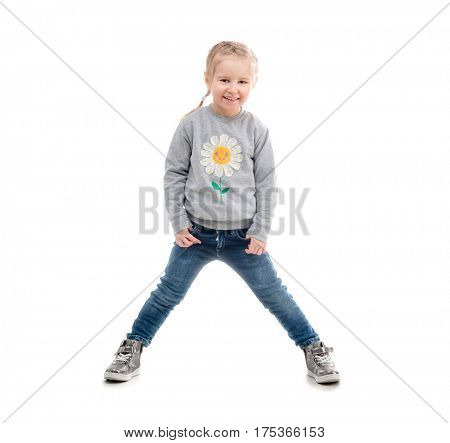 Girl standning in a wide stance, wearing gray sweatshirt with a daisy on it, isolated