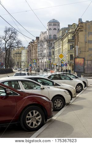 Kronverskiy Avenue St. Petersburg the cars parked along the road buildings Sunny day architecture Russia tree spring road signs