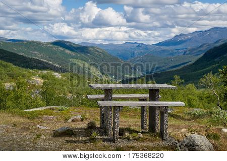 Place for traveller's rest in the mountain road of Norway. Table and bench at canyon viewpoint. National travel route of Norway, road 55.