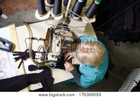 Worker in textile fabric. Hoisery factory. Socks production