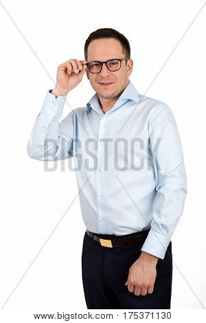 Young Handsome Man In Formal Shirt And Trousers Wearing Fashion Eyeglasses Against White Background