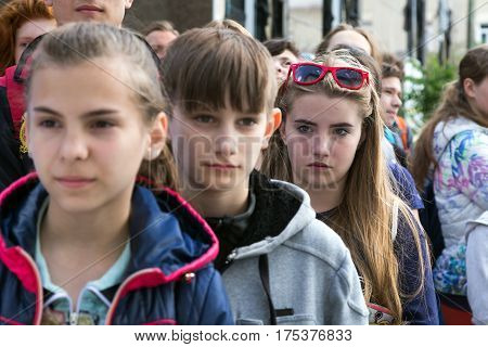 Opening ceremony of National Climbing Championship - junior participants stays at square place in front of climbing Gym and listen a Speaker expressing diverse emotions. Dnipro, Ukraine, May 20, 2016