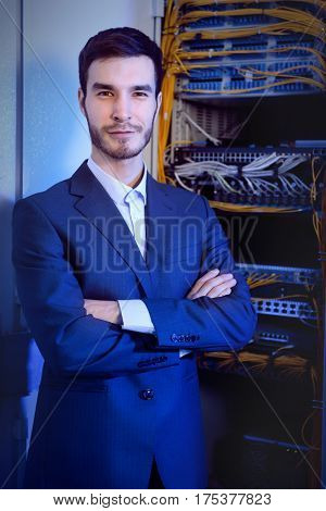 Handsome young engineer in server room