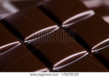 Milk and dark chocolate on a wooden table