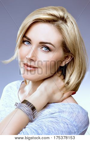Close-up portrait of a beautiful well-groomed middle-aged woman. Skincare, rejuvenation, cosmetics. poster