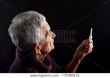 Senior woman Laxative on a black background