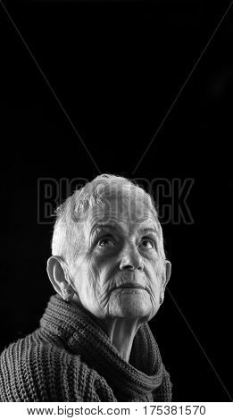 Portrait of a Senior woman on black