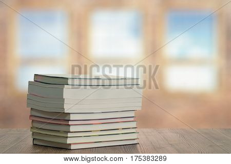 books on wooden table in the living room