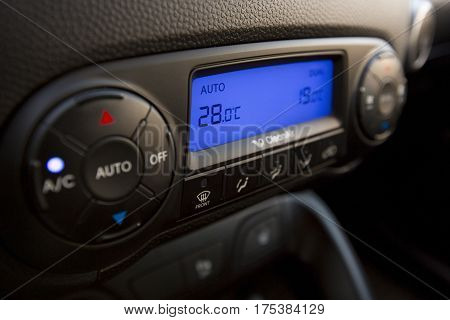 Closeup of Modern Air Conditioning and Heating Control Panel of a Car