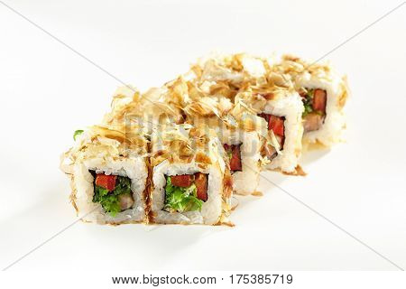 Japanese Sushi Food - Sushi Roll with Chuka Seaweed and Vegetable inside. Dried Shaved Bonito outside. Maki Sushi on White Background