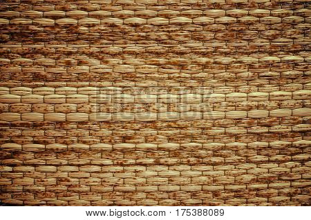 Wicker woven beige mat handmade for background.