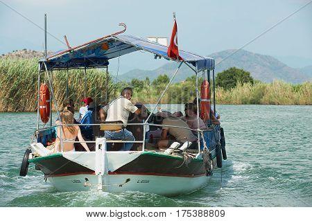 MUGLA, TURKEY - AUGUST 13, 2009: Unidentified tourists enjoy boat cruise by the Dalyan river in Mugla, Turkey.