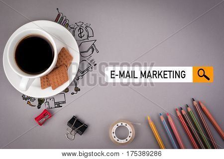 e-mail marketing concept. Gray office desk with the inscription.