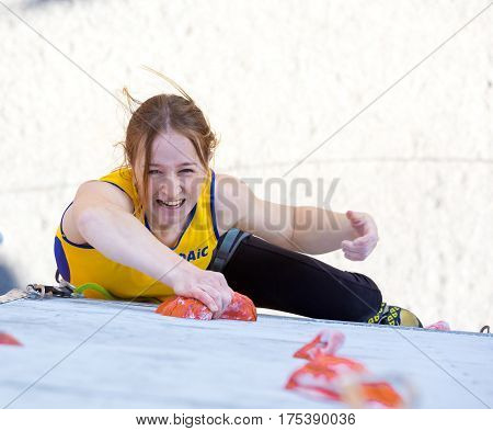 Female climber makes a try on the track of lead climbing competition. National Climbing Championship, Dnipro, Ukraine, May 20, 2016, Female semifinal, Lead climbing