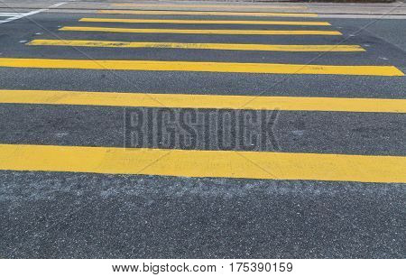 Yellow crosswalk on asphalt picture background detail