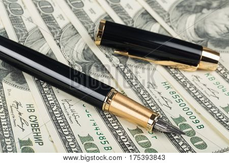 Parker Fountain Pen and Pen Cap Lying on the Money - Close Up