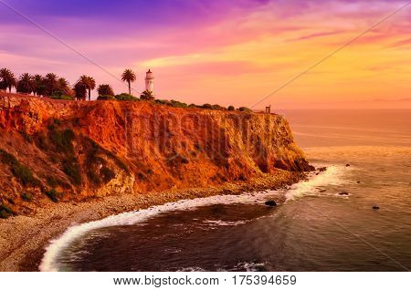 The Point Fermin lighthouse by the water at sunset