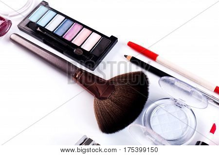 Makeup cosmetics, brushes and other essentials on white background. Flat lay. Multicolored beauty tools and products collection, lipsticks, eyeshadow, pencils, blush