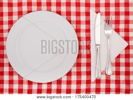 Table Setting with Plate, Fork and Knife on Checkered Table Cloth