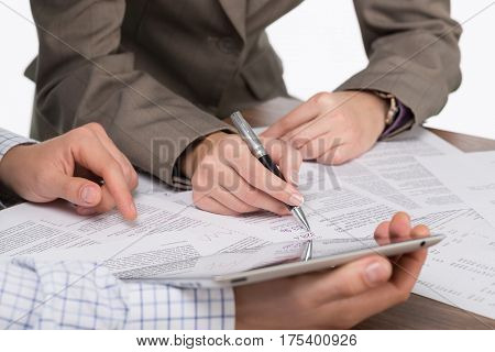 Closeup of Business People Working with Tablet and Financial Figures