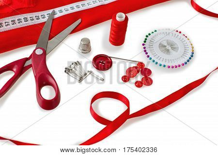 Sewing tools - scissors, buttons, sewing pins, sewing needle, safety pins, thread and fabric