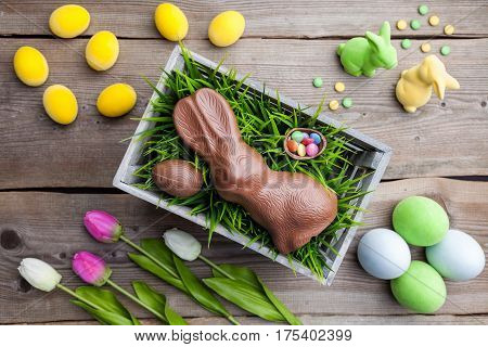Traditional Easter Decoration Background With Flowers, Bunnies And Eggs