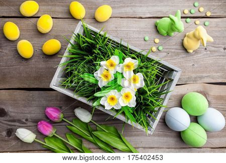 Easter Holiday Background With Fowers, Eggs And Bunnies