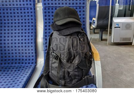 Inside of a new train passenger carriage with knapsack and two winter hat of photographers, Koprivshtitsa,  Bulgaria