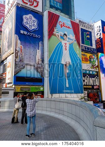 OsakaJapan - October 27 2014 : For a limited time only the actress Haruka Ayase will be pictured on the giant Glico signboard the symbol of Osaka Dotonbori.