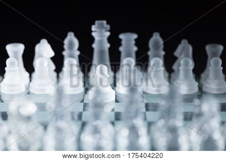 View of a Chessboard from Behind the Chess Pieces