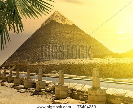Pyramid of Khafre near road in bright sunlight