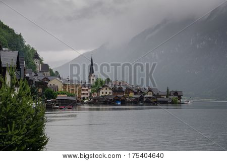 The Beautiful View Of Hallstatt Ar Foggy Evening