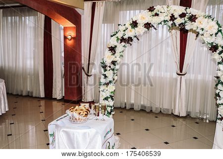 stylish luxury decorated arch for the celebration for a wedding of happy couple cathering in the restaurant