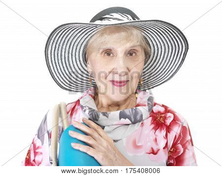 Senior female wearing beautiful hat with a travel or shopping bag on a shoulder studio shot on white