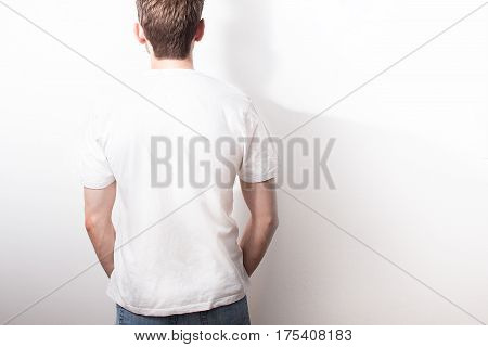 The Guy In The Blank White T-shirt, Stand,  Smiling On A White Background, Mock Up, Free Space, Logo